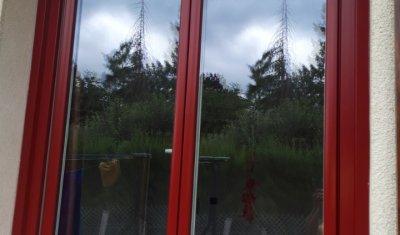 Fourniture et pose d'une fenêtre en PVC plaxé rouge carmin proche RAL3011 à Clermont-Ferrand