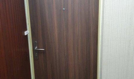 Fourniture et pose d'une porte palière avec placage bois à Chamalières