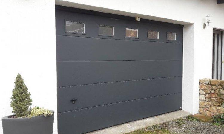 Porte de garage sectionnelle motorisée à Clermont-Ferrand